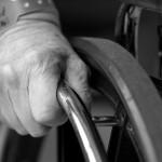 elderly man's hand on wheelchair