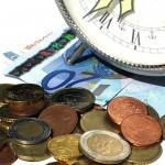 clock on top of money